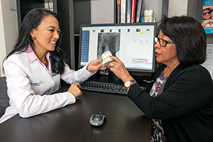 Dr. Johnson and a patient discuss treatment options during a full-mouth rehabilitation consultation.
