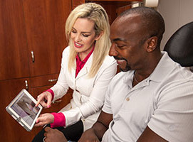 Dr. Alvarez educates a patient about how to maintain a healthy smile and gums.